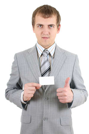 Young businessman showing a blank business card over white photo