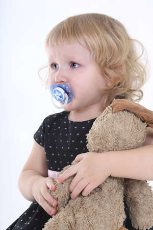 little girl with toy crying over white background Stock Photo