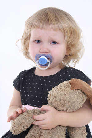 little girl with toy crying over white background Stock Photo - 8456393