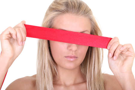 blindfolded: Young woman blindfolded over white background
