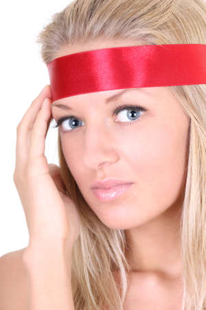 Young woman with red ribbon on head photo