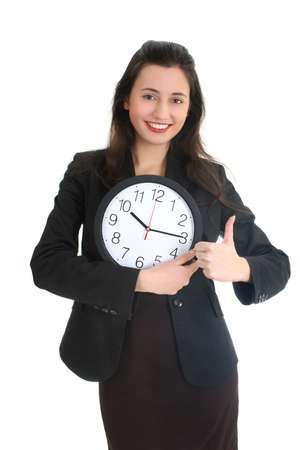 Businesswoman in suit holding a clock and showing a thumbs up gesture over white Imagens