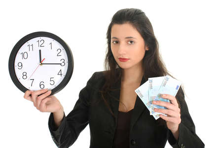time to work: Businesswoman in suit holding a clock and money over white