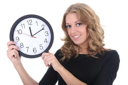 puntualidad: Mujer feliz en negro con reloj sobre blanco