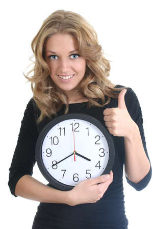 Happy woman in black with clock showing thumbs up over white