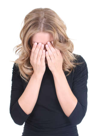 Crying blonde woman in black over white Stock Photo
