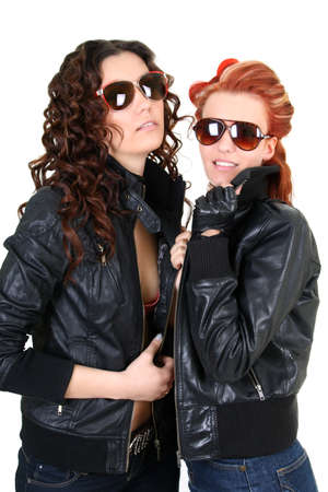 red haired girl: Two glamorous woman in leather jackets and sunglasses