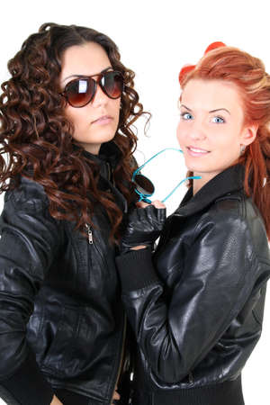 leather glove: Two glamorous woman in leather jackets and sunglasses