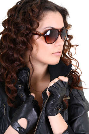 Glamorous brunette woman in leather jacket and sunglasses Stock Photo - 9450511