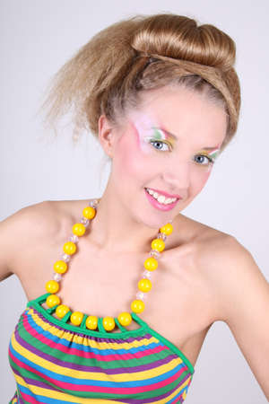 Young woman in dress with creative make-up and coiffure photo