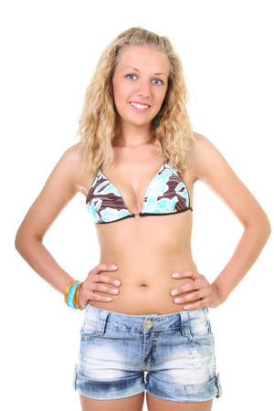 Happy young blonde woman in summer clothes photo