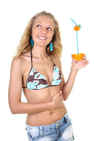 Young woman with orange juice in hand photo