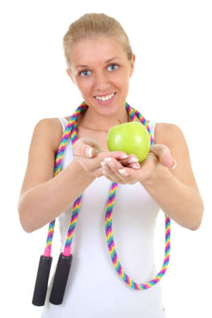 girl with skipping rope and apple. focus on apple photo