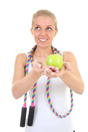 girl with skipping rope and apple over white photo
