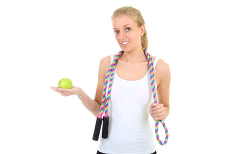 girl with jump rope and apple over white photo