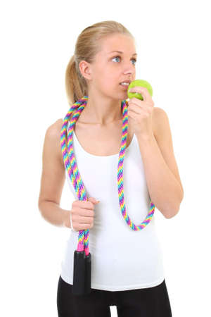 girl with skipping rope biting apple over white photo