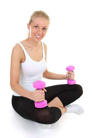 attractive blonde with dumbbells sitting isolated over white background photo