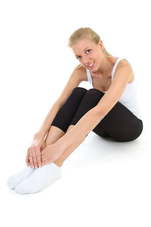 young sporty woman sitting over white Stock Photo - 11561065