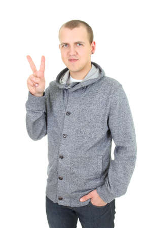casual young man showing a victory sign over white photo