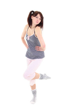 posing woman in pajamas over white, full length photo