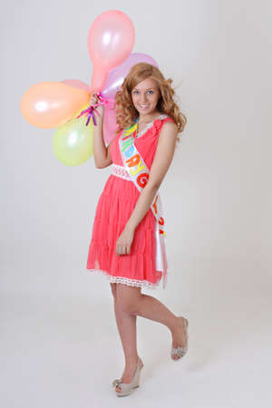 Happy blonde birthday girl with balloons photo