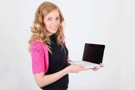 Happy young woman with laptop over white photo