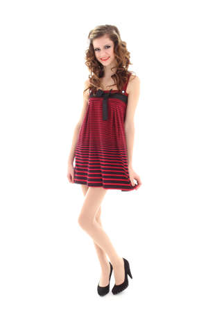 girl in red dress standing isolated over white background Stock Photo - 12930262