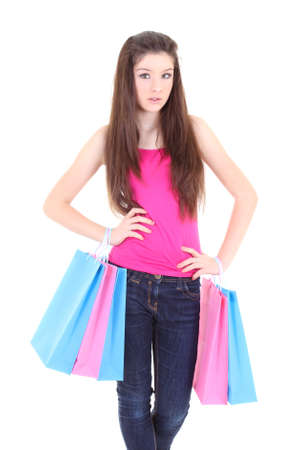 teenager in pink t-shirt with shopping bags over white photo