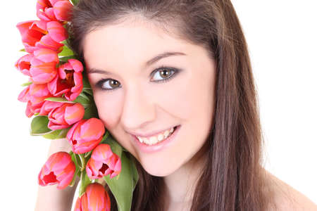 Close-up portrait of girl with pink tulips over white photo