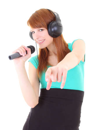 Happy teenager with headphones and microphone singing photo