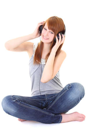 Happy teenager with headphones sitting over white photo