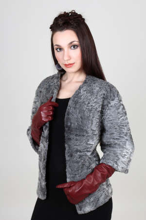 short gloves: Woman in gray fur coat with gloves Stock Photo