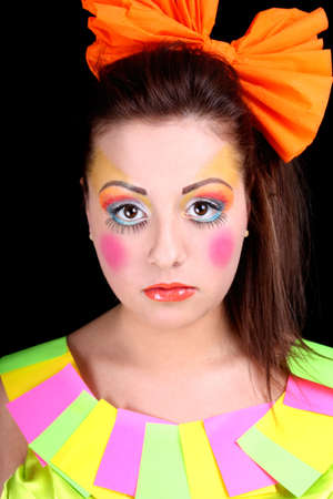 Woman in doll style with creative make-up over black photo