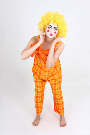 Portrait of surprised clown with orange bow Stock Photo - 13624878