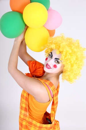 Funny clown in costume with colourful balloons Stock Photo - 13624915