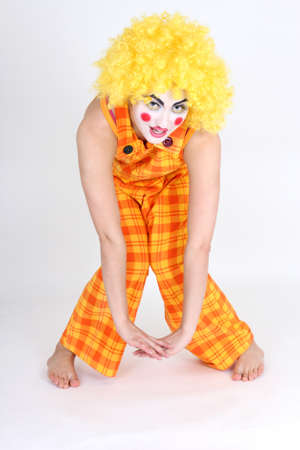 Funny clown in colorful costume and make-up photo