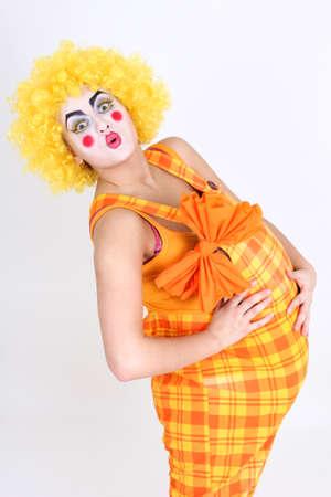 Happy clown in costume with big abdomen photo