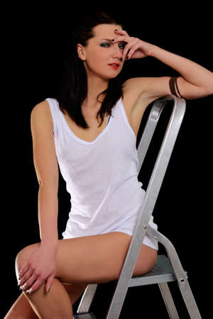 Sexy woman in white t-shirt in ladder