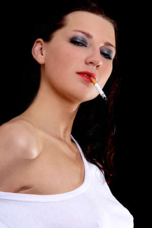 portrait of woman with cigarette over black Stock Photo - 13854808