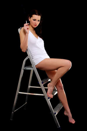 Sexy woman in white t-shirt in ladder photo