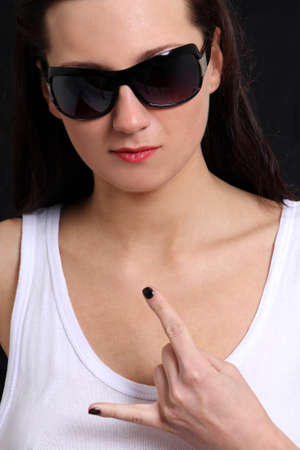 Sexy woman in sunglasses and t-shirt over black Stock Photo - 13854818