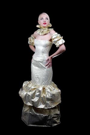 Beautiful woman in golden venetian dress over black Stock Photo - 13854805