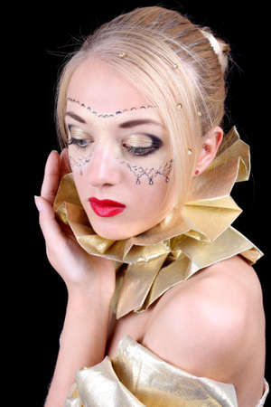 Beautiful woman with golden venetian mask on face photo
