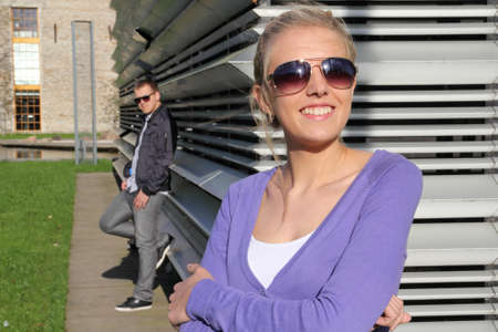 Attractive couple in park in sunglasses smiling photo