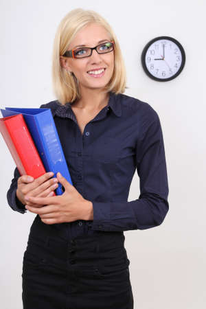 businesswoman with folders over white photo