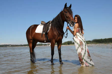 Girl with horse on the beach Stock Photo - 14902803