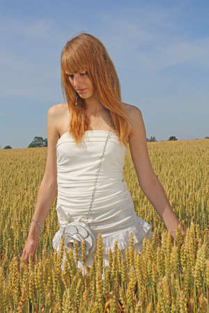 Beautiful redhaired girl in the field photo