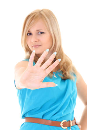 young woman showing his hand signaling stop on white background photo