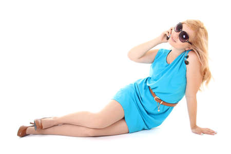 attractive girl in blue dress using her mobile phone over white background Stock Photo