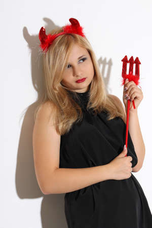 Blonde girl wearing a red costume of an imp photo